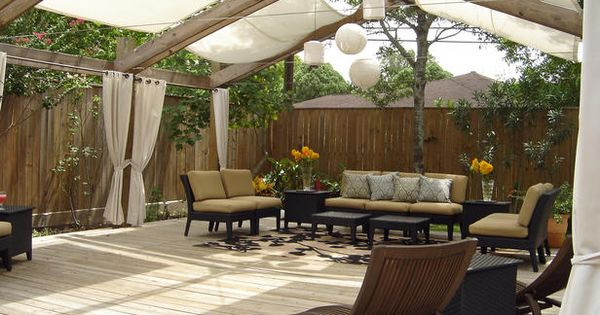 Outdoor space! Sailcloth shades this outdoor room from the sun while the