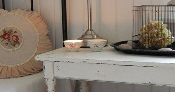 Iron bed frame, distressed side table, whitewashed plank wall. vintage lamps |