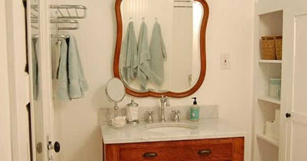 Great retro bath! Wonderful ceiling color, great built ins, repurposed antique dresser,