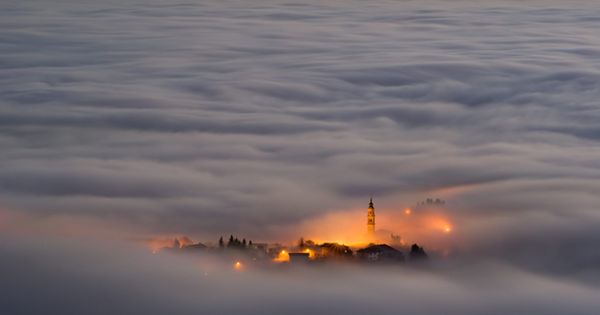 Asiago plateau, Italy, shrouded in fog, taken from the top of a