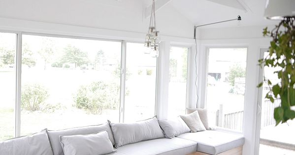 Long skinny sunroom idea done with built ins rather than individual beds