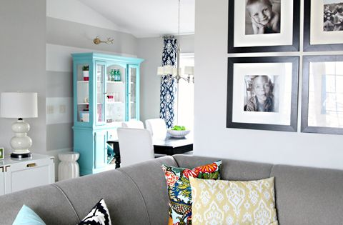 LOVE this color scheme for the living room. Navy, tiffany blue, pop
