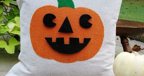 Pumpkin pillow with interchangeable faces.