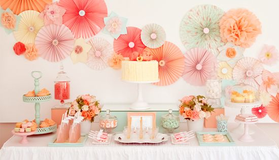 Pretty and feminine spa after party decoration with paper flowers and bite