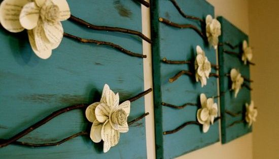 Canvas, paper flowers, and sticks. I think this would be awesome to