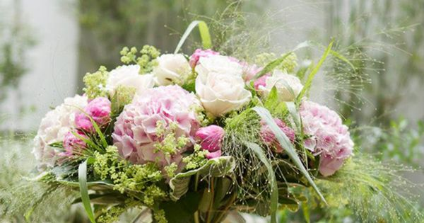 A Hand Tied Bouquet Using Peonies Roses Hydrangeas