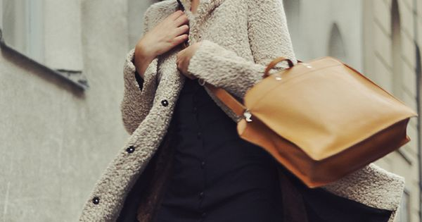 the perfect outfit! Furry coat, hat, black dress, cognac bag and nice