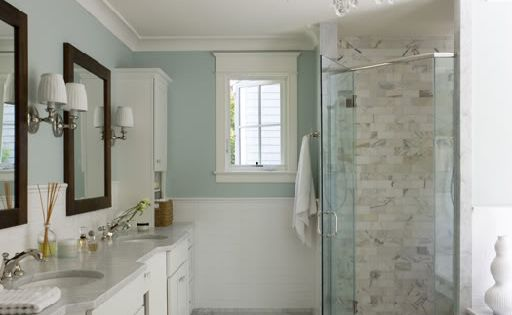 Gorgeous master bathroom design with spa blue walls paint color, chair rail
