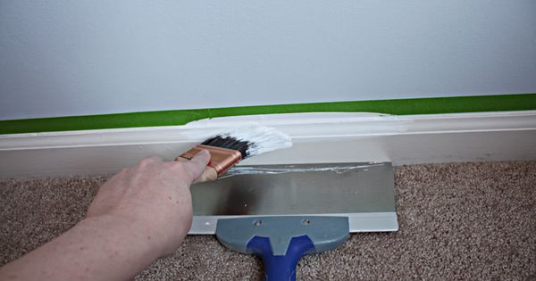 Paint trim without it getting on the carpet. A dust pan works