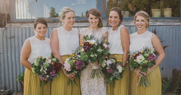 I love everything about this photo - the bride's dress, the mustard