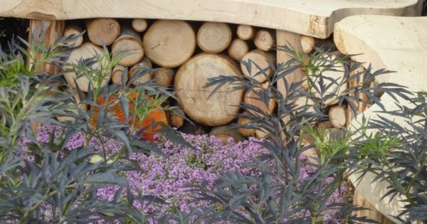 In the 'It's Only Natural' wildlife garden  a curved wooden bench doubled