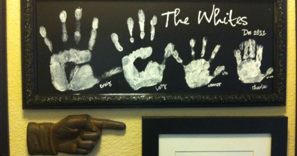 family handprint wall art. Would be cute with some doggy paw prints