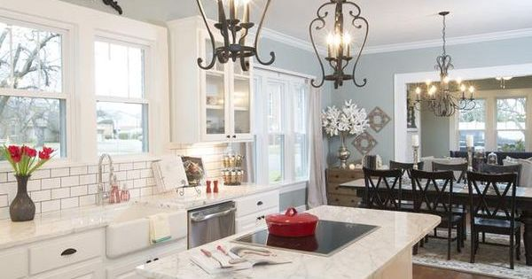 Gorgeous kitchen! Cool lighting above island. Farmhouse sink. Paint color. White cabinets.
