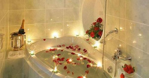 romance is everything, set the mood with candles and rose ...