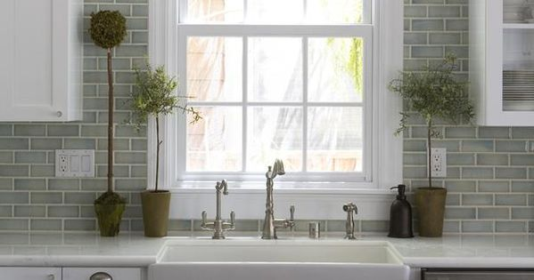 Beautiful subway tile back splash and farm sink.