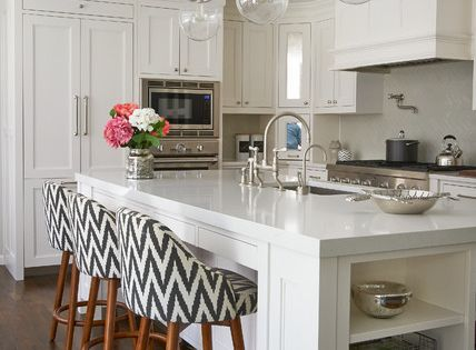 This is an example of a mid sized transitional l shaped for Atrium white kitchen cabinets