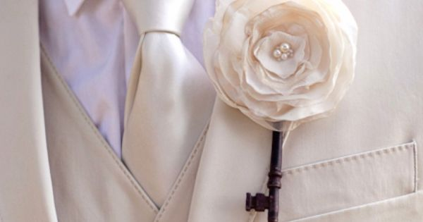 Boutonniere with a stem made from an old key. Maybe with baby's