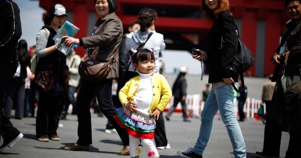 This little girl struck a pose for her mom in Shanghai. YOU