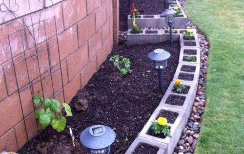 25 Garden Bed Borders, Edging Ideas for Vegetable and Flower Beds. This concrete block idea is neat - especially if you paint the blocks pretty colors hmm this would be a great idea for the raised beds in the front!