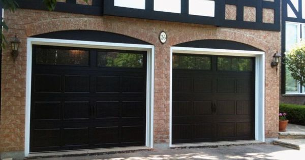 Close Up Of Black Garage Doors On Brick House Garage