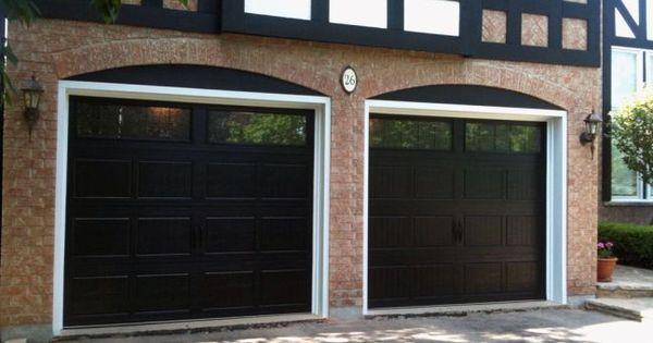 Close Up Of Black Garage Doors On Brick House Garage