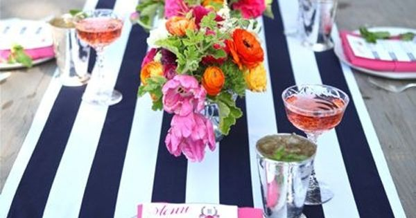 Navy striped table runner and bright flowers