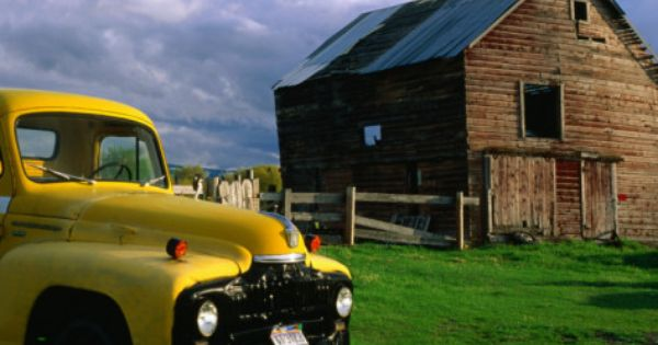 Old Barn And Yellow Pick Up Truck In Montana Montana Usa
