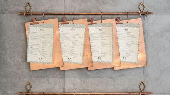 These menus on copper clipboards are hung on a copper pipe for Come collegare pex pipe al rame