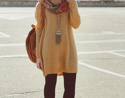 big sweater, leggings, scarf, statement necklace, up-do, and boots