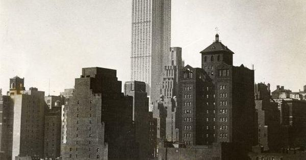 Zeppelin near the Empire State Building that's still under construction in 1930.
