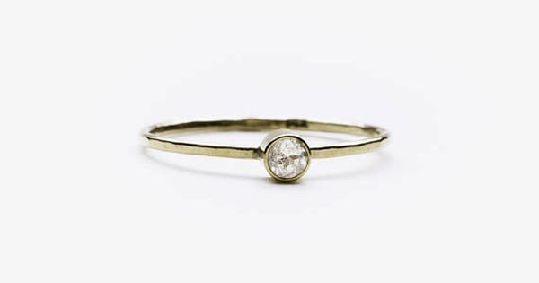 A Slim Band Of Polished Sterling Silver Or 14 Karat Gold And One
