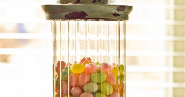 Mixed unwrapped Easter candy in a pretty apothecary jar makes a simple