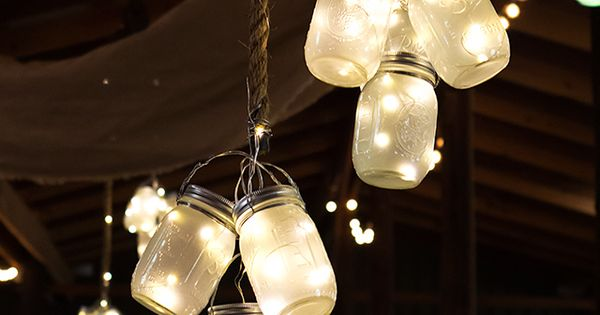 Clusters of frosted LED mason jar lights hung from the ceiling at