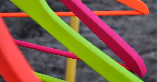 Spray paint wooden hangers to neon colors! Love!