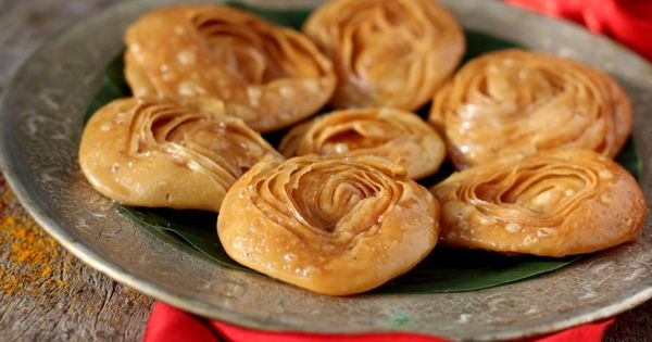 Chiroti recipe - a fried flaky pastry topped with powdered sugar or