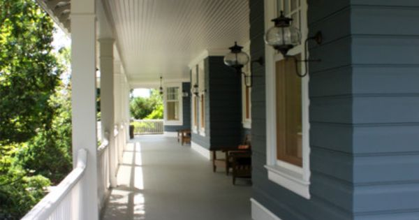 Dark Gray Siding With Light Gray Porch Deck And White