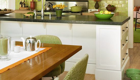 Green glass subway tile adds a dash of excitement to this open