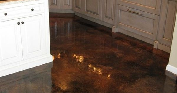 acid stained concrete flooring with gloss finish. Easy to clean, compliments hardwood floors, and has NO GROUT!! remove old carpet and stain floor.