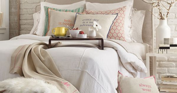 Bedroom idea: taupe and white everything. Mixed textures, chevron pouf ...