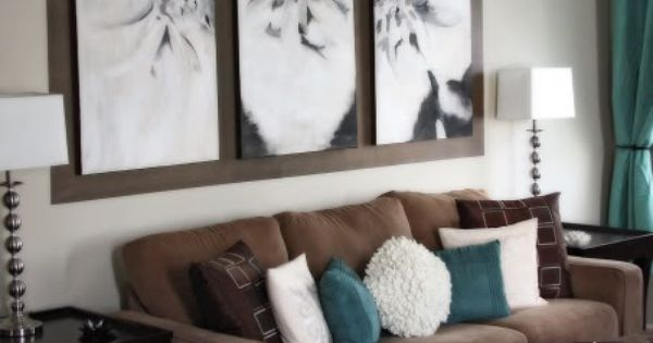 teal accents on a chocolate brown couch - I like the gallery