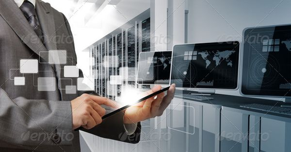 Businessman holding a tablet in controls computer room