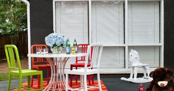 Bright Colored Outdoor Furniture Brings Life To This Black