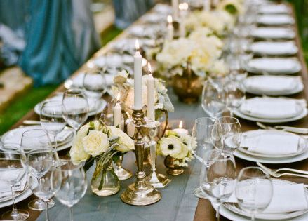 candles, simple white flowers, farm tables