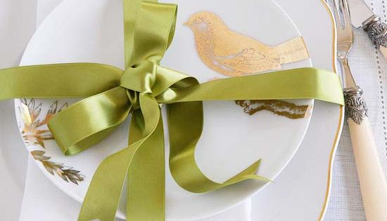 Mimic the gifts under your tree by wrapping your Christmas table setting