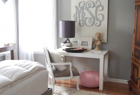 love the desk chair & monogrammed canvas but the overlapping rugs bother