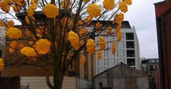 Yellow umbrella tree installation from Street Art Utopia.