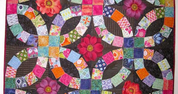A Double Wedding Ring Quilt Made With Raw Edge Applique