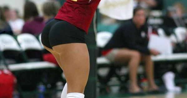 Smiling Female Volleyball Player Standing With Arms