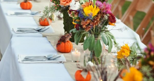 Too cute... love this! An autumnal wedding table decorated with pretty flowers