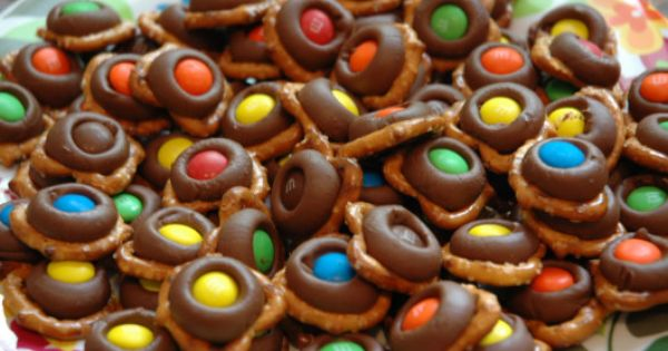 Great party food - Just melt Hershey's kisses onto tiny twist pretzels